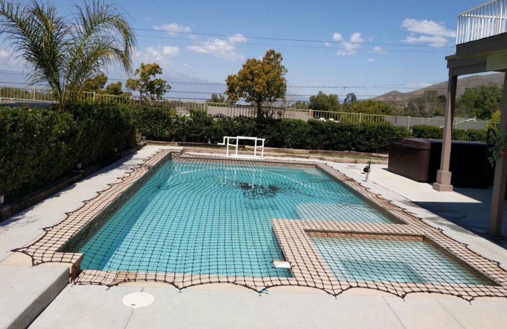 Installed pool net on a backyard pool