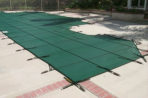 mesh pool cover installed on a swimming pool